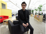 Box CEO Aaron Levie sitting on a chair posing for a photo.