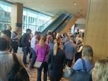 Attendees of the DX Summit wait outside a breakout session.