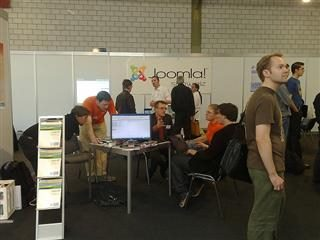 people in front of joomla booth at conference