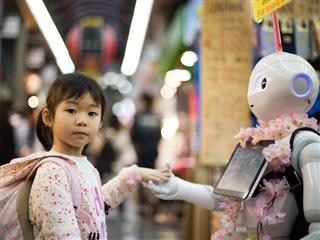 girl with hand in robot's