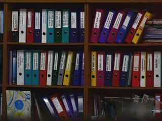 records management the old fashioned way, in binders on a shelf