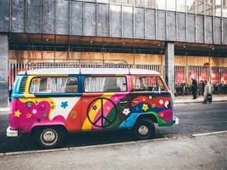 volkswagen van painted with psychedelic colors and symbols