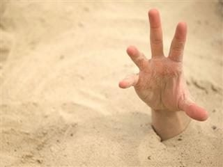 hand reaching out of quicksand