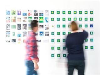 branding exercise with sticky notes and more on a wall