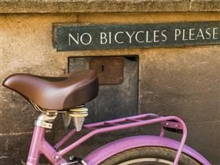 no bicycle sign with a bicycle in front of it