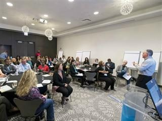 Attendees at the Digital Workplace Experience 2019 conference listen to a speaker in a breakout session.