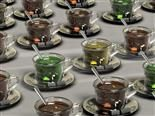 rows of glass cups filled with tea