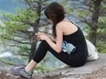 woman with cellphone on mountain