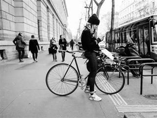 woman texting while on a bicycle