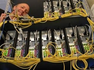 man working on computer servers