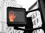 "street signal using a hand to mean ""don't walk"""