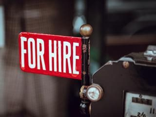 for hire sign on side of taxi
