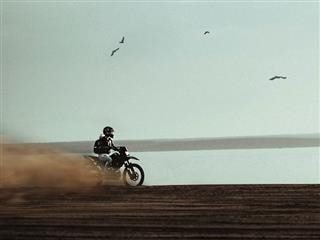 motorcycle kicking up dust