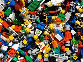 Many, many pieces of Lego toy pieces in one image.