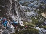 three mountain climbers going uphill in rocky terrain in Portugal