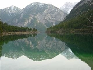 Mountains reflected in water.