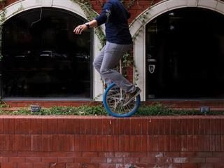 unicycle balancing on a wall