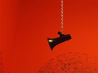 megaphone dangling from a chain