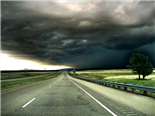 A highway scene with Stormy weather ahead - trouble ahead concept