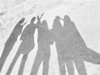 photo of a group of five people's shadows