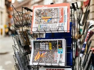 Newspapers on a French newsstand outside featuring news from Spain about the Catalonia Referendum and protests in Barcelona.