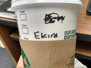 Starbucks cup with multiple name misspellings