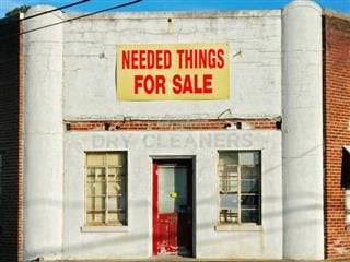 Sign on abandoned building: Needed Things for Sale