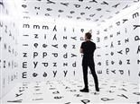 man standing in room covered in font