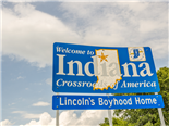 "A blue ""welcome to Indiana"" sign."