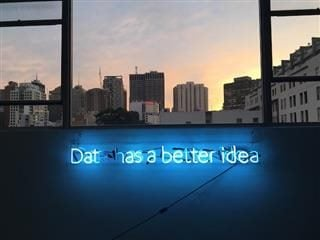broken neon sign reading: dat has a better idea