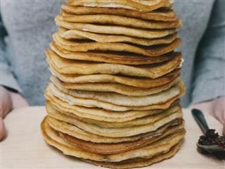 very tall stack of pancakes
