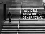 "woman walking down stairs with quote written on them: ""all ideas grow out of other ideas"""