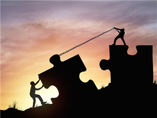 Silhouette people helping to connect jigsaw and puzzle to success - employee experience concept
