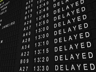 flight board with a list of delayed flights