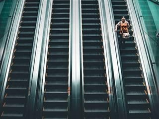 walking down an escalator