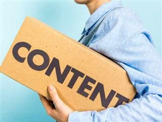 "Woman carrying a box with the word ""content"" in front."