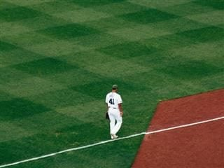 baseball player walking in the infield
