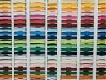 a wall of colored paper, organized according to shade