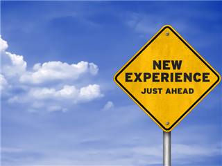 New experience road sign, set on a blue sky - digital experience concept