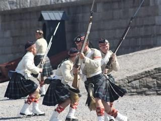 men in kilts doing military manouevres