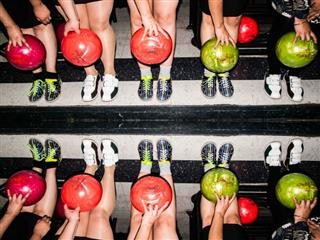 10 women with bowling balls