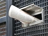 A newspaper stuck into the mail slot on a residential door - Newsbyte Concept