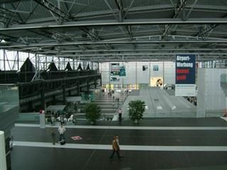 a rather empty-looking Dresden International Airport terminal.