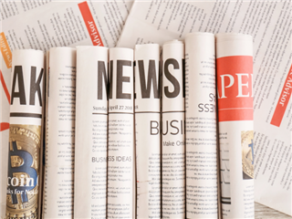 newspapers rolled up sitting next to each other. each roll has a letter. all of the rolls spell news - Newsbyte concept