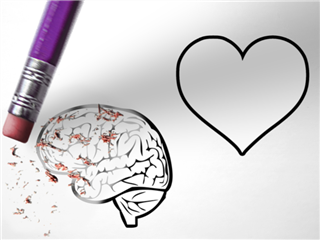 A heart and a brain written on paper and an eraser deleting the reason instead of the feelings