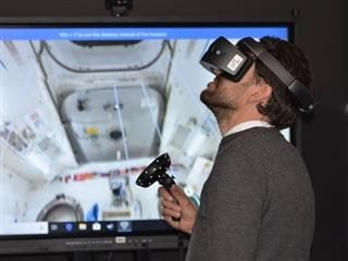 man wearing virtual reality goggles going through a simulation