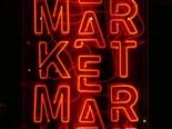 "neon sign reading ""market"" over and over again"