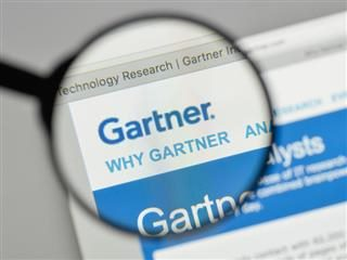 A magnifying glass peering at the Gartner website - magic quadrant analysis