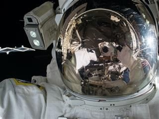 close up of  an astronaut making repairs in  space