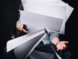 office worker drowning in paper